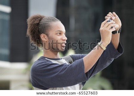 Young tourist taking a self portrait - stock photo