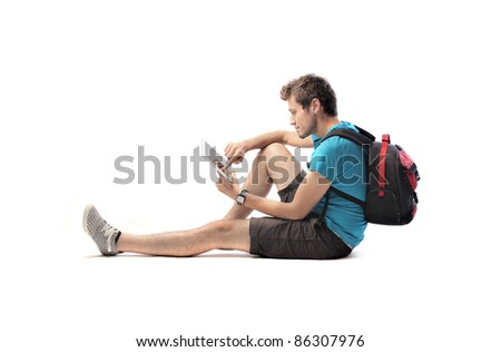 Young tourist using a tablet pc - stock photo