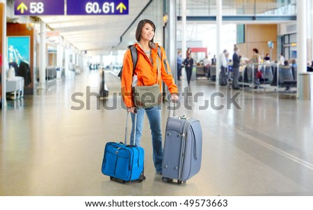 Young tourist woman at airport - stock photo