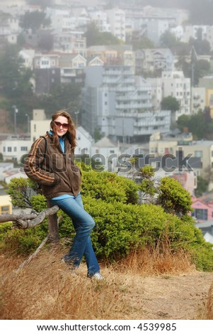 Young tourist woman enjoying scenic view outdoors ontop of the Kite Hill in San Francisco - stock photo