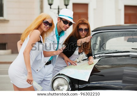 Young tourists with a road map - stock photo