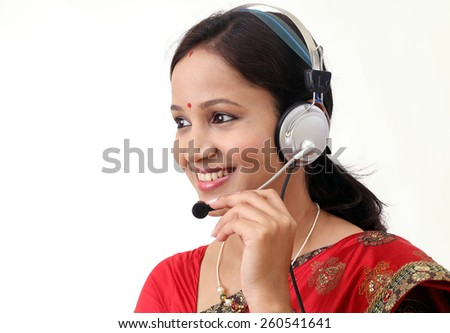 Young traditional customer service representative woman with headset - stock photo