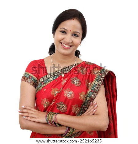 Young traditional Indian woman against white background - stock photo