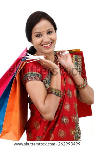Young traditional Indian woman holding shopping bags  - stock photo