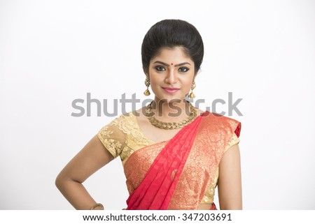 Young traditional Indian woman in traditional saree on white background. - stock photo