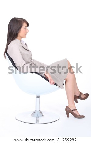 Young trainee sitting in armchair - stock photo
