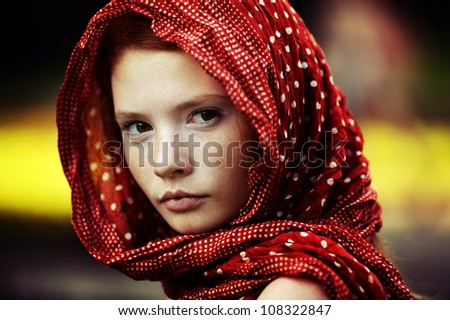 Young tranquil woman outdoors portrait