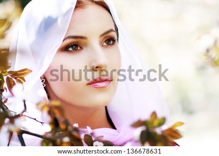 Young tranquil woman outdoors portrait. Spring blossom - stock photo
