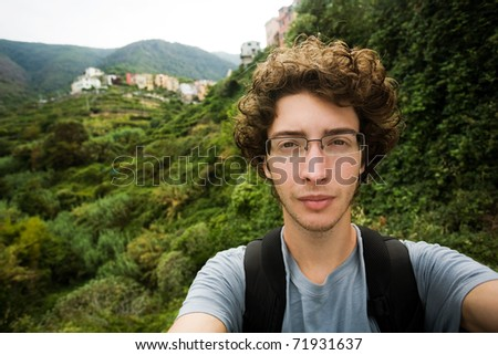 Young traveler and hiker looking at the camera, Cinque Terre Italy - stock photo