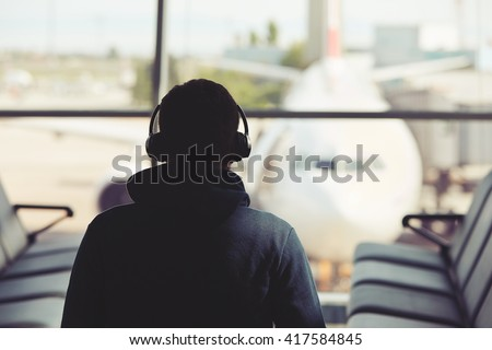 Young traveler is waiting at the airport - stock photo