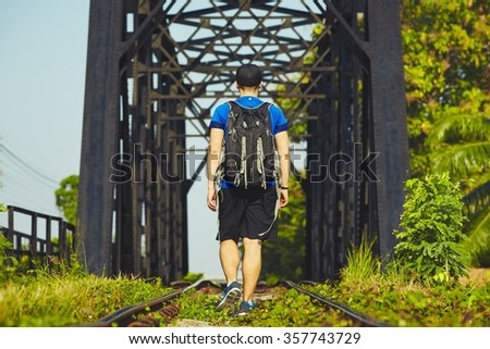 Young traveler with bagpack traveling in Asia  - stock photo
