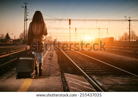 Young traveler woman in railway - stock photo