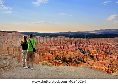 Young Travelers Couple standing on the cliff of Bryce Canyon National Park, Utah USA