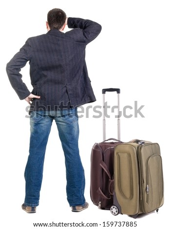 young traveling expert with suitcas looks ahead. Back view people. Isolated over white . - stock photo
