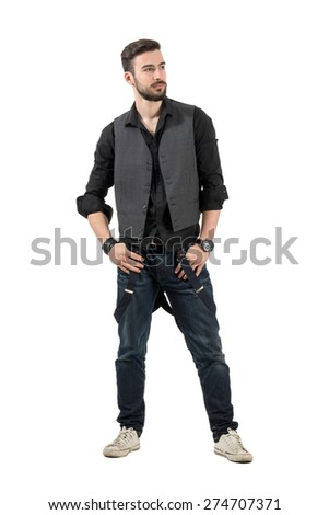 Young trendy fashion male model looking at distance. Full body length portrait isolated over white background.