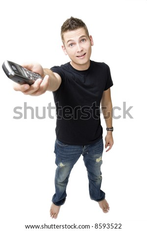 young trendy male handing out a phone - stock photo