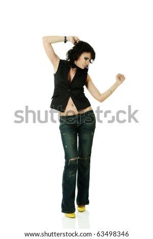 Young trendy stylish sexy woman dancing in disco style - stock photo