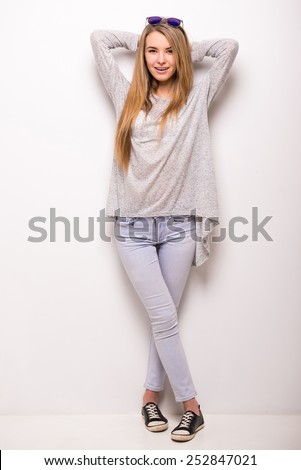 Young trendy woman is posing on white background. - stock photo