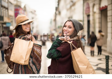 Young trendy women shopping in the city - stock photo