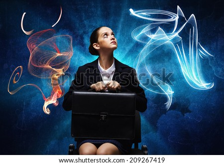 Young troubled businesswoman making choice between good and bad - stock photo