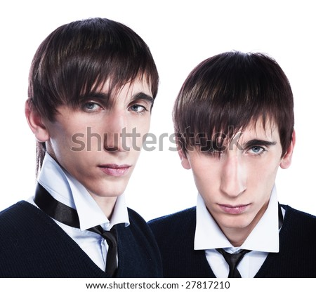 Young twins with fashion haircuts isolated on white - stock photo