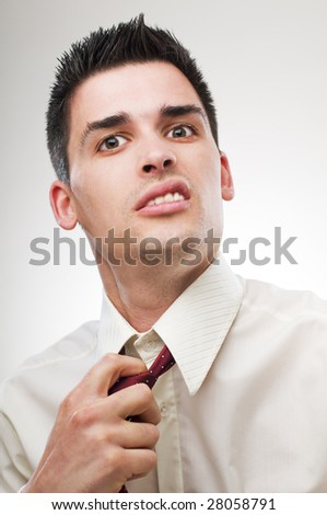 young unhappy business man close up portrait - stock photo