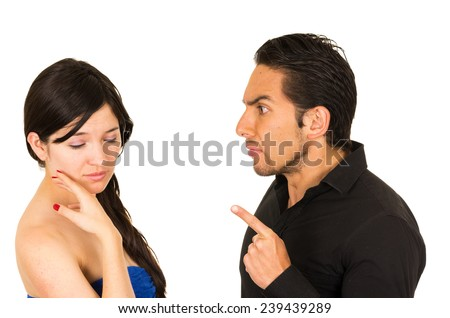 young unhappy woman having an argument with angry husband boyfriend isolated on white - stock photo
