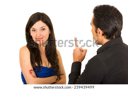 young unhappy woman ignoring husband boyfriend in an argument isolated on white - stock photo