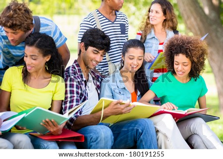 Young university students studying together on college campus - stock photo