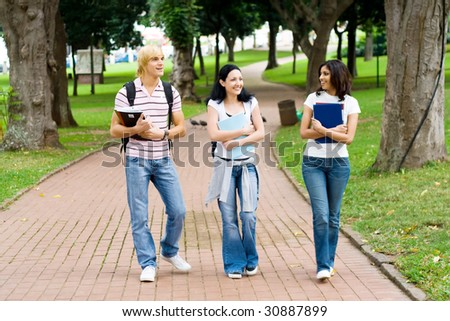 young university students walking in campus - stock photo