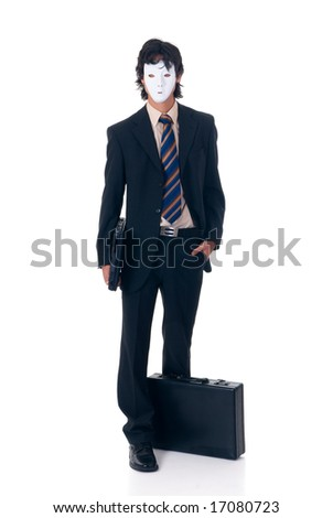 Young unknown successful businessman wearing Halloween mask.  studio shot, white background - stock photo