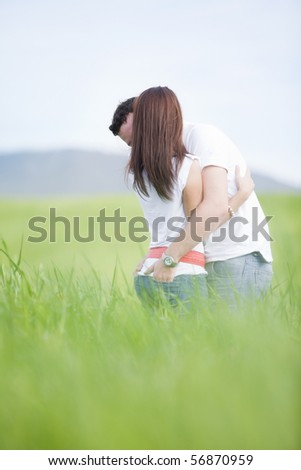 Young unrecognizable couple united in a hug. - stock photo