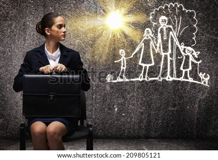Young upset businesswoman sitting on chair with briefcase - stock photo