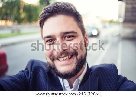 Young urban Business man taking selfie - stock photo