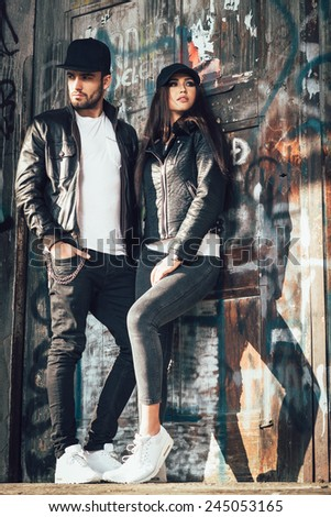 Young urban couple posing - stock photo