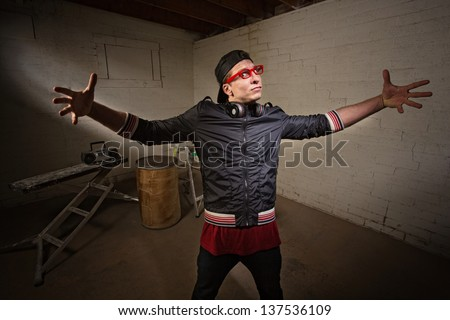 Young urban man with open arms in big expression - stock photo