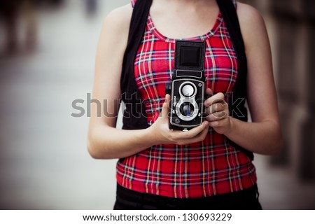 Young urban unrecognizable vintage photographer with old 6x6 camera. - stock photo