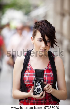 Young urban vintage photographer with old 6x6 camera. - stock photo