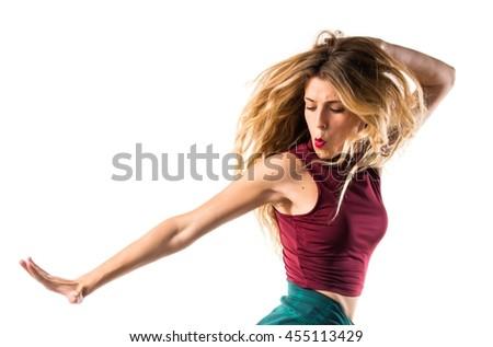 Young urban woman dancing - stock photo
