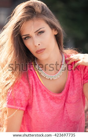young urban woman  in pink t-shirt city portrait