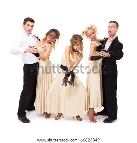 Young vampires dancing against isolated white background - stock photo