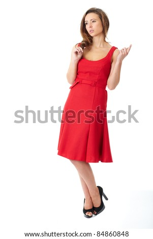 Young very attractive female in red dress pose over white background