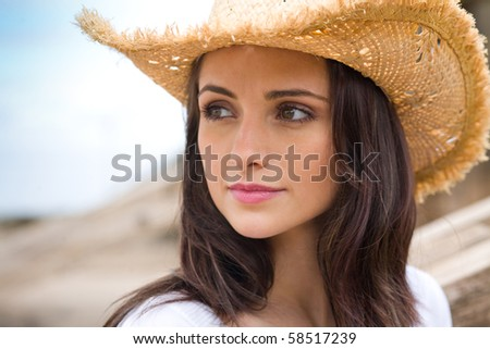 young very attractive female in straw hat, holidays and relaxation concept - stock photo