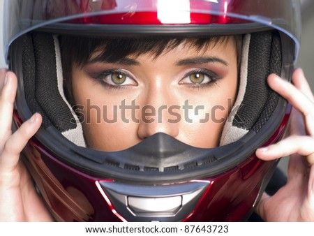 Young Vibrant Intense Girl in Red Full Face Motorcycle Racing Helmet - stock photo