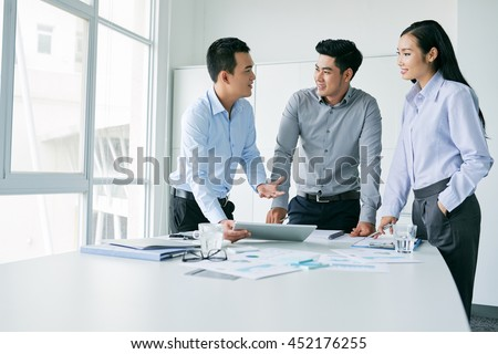 Young Vietnamese business team planning work together - stock photo