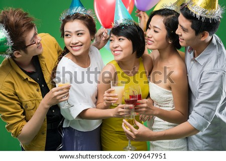 Young Vietnamese people clinking at the party