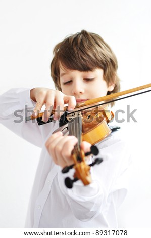Young violin player - stock photo