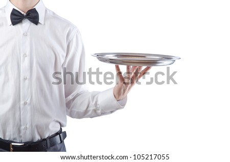 Young waiter with silver tray - stock photo