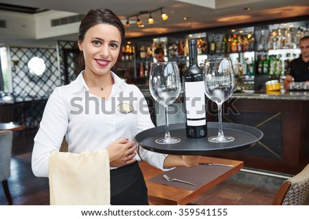 young waitress at service in restaurant - stock photo