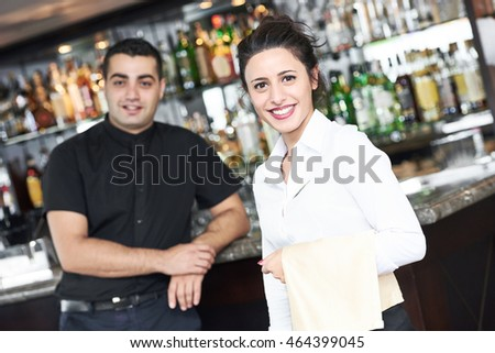 young waitress at service in restaurant